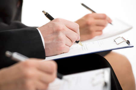 Businesspeople hands over papers making notes at seminar   photo