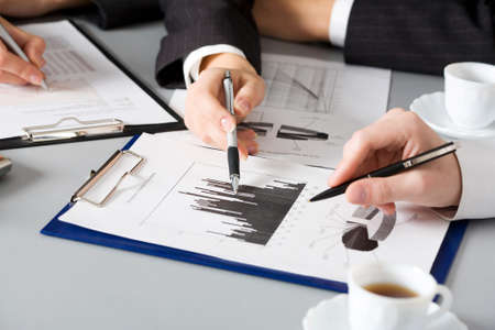 Image of business people hands working with documents at meeting photo