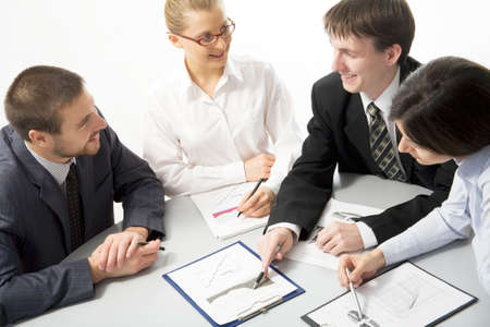 Young businessman showing chart his colleagues photo