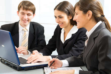 Young business people working in an office Stock Photo - 9875660