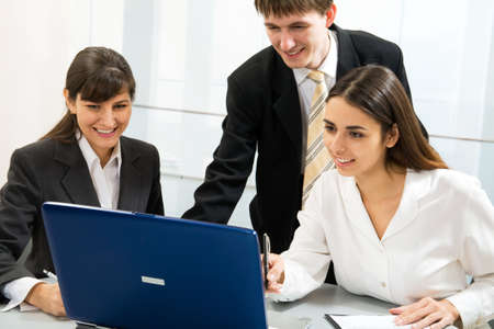 Young business people working in an office photo