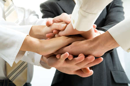 altogether: Business people hands on top of each other