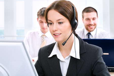 office environment: A friendly secretarytelephone operator in an office environment.