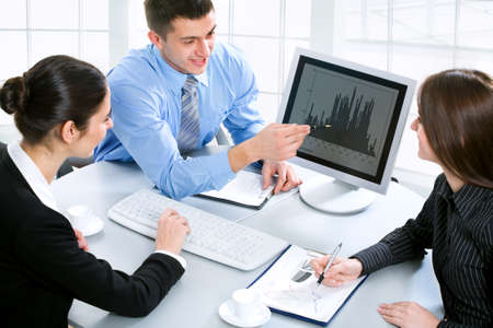 Business team at a meeting in a  modern office environment photo