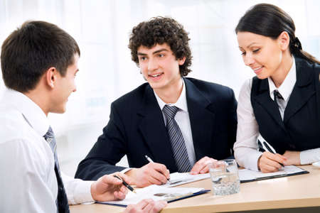 Modern business people work at a seminar photo