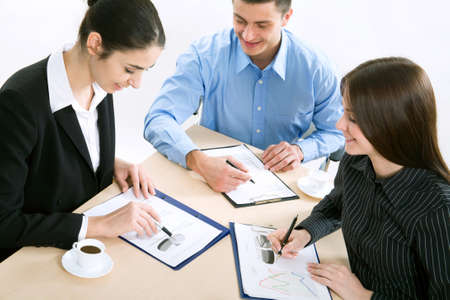 sales occupation: Image of successful partners discussing business plan at meeting