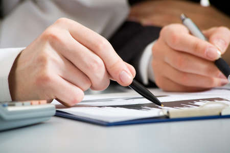 reviews: Image of business people hands working with documents at meeting