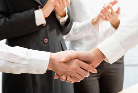 great suit: Shaking hands of two business people