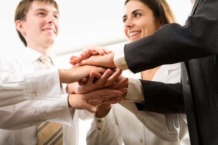 integrity: Image of business people hands on top of each other