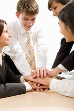 unanimous: Business team putting their hands on top of each other