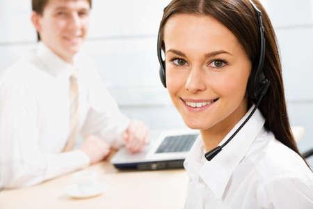 telephony: A friendly secretarytelephone operator in an office environment.