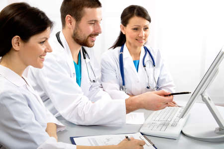 Group of young doctors discuss work photo