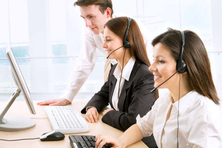 contact center: Telephone operators working in an office