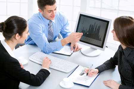 computer worker: Business team at a meeting in a  modern office environment