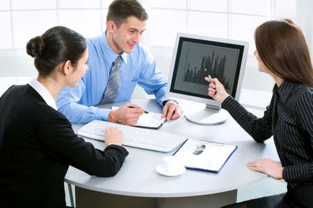 officeworker: Portrait of three businesspeople discussing plan at meeting   Stock Photo