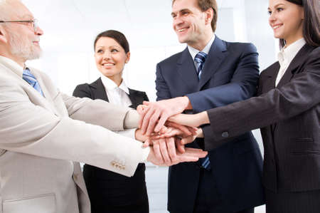 Business people joining their hands photo