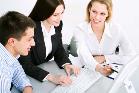 explanations: Business team at a meeting in a  modern office environment