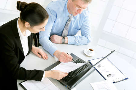 explanations: Image of successful partners discussing business plan at meeting