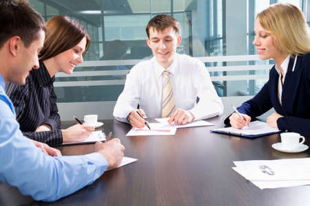 Business team at a meeting in a  modern office environment Stock Photo - 10184738
