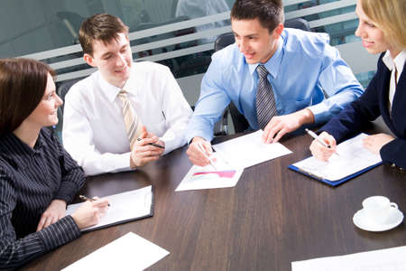 Business team at a meeting in a  modern office environment Stock Photo - 10184774