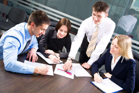 Business team at a meeting in a  modern office environment Stock Photo - 10184786