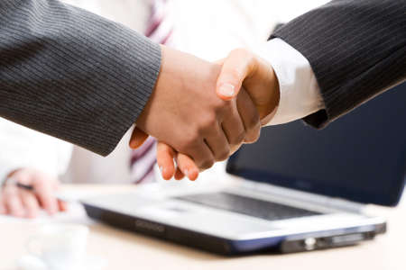 great deal: Close-up of hands shake between two successful business people