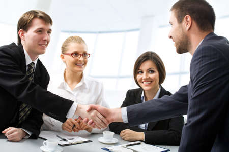Successful people shaking hands making a necessary agreement  photo
