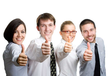 Successful business team with thumbs up - isolated over a white background   photo