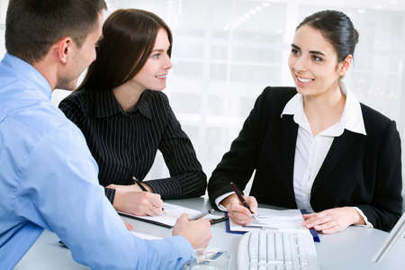 Businesswoman explaining a new project to colleagues Stock Photo - 10492670