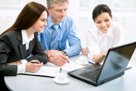 group plan: Business people in an office environment