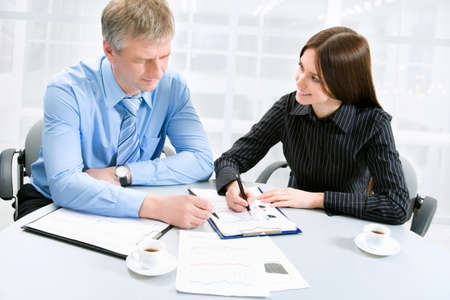 Business man and woman in a meeting photo