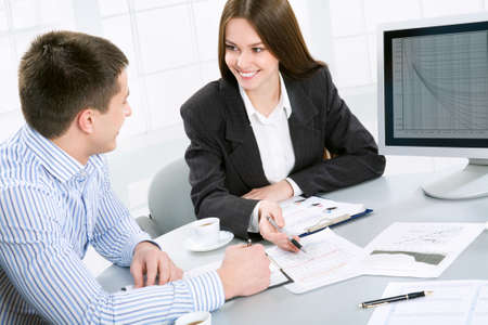 financial planner: Young business people at the office Stock Photo