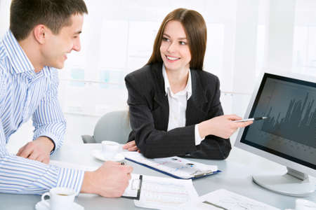 financial guidance: Business meeting - Happy businesspeople talking