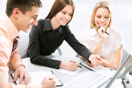 Business meeting - Happy businesspeople talking Stock Photo - 10492826
