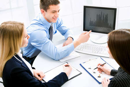 Business meeting - Happy businesspeople talking Stock Photo - 10492588
