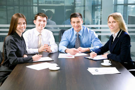 financial planner: Business meeting - Happy businesspeople look at camera