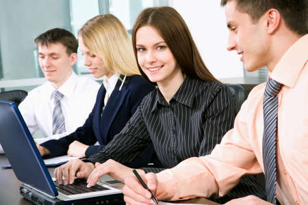 net meeting: Successful businesswoman and colleagues working at office