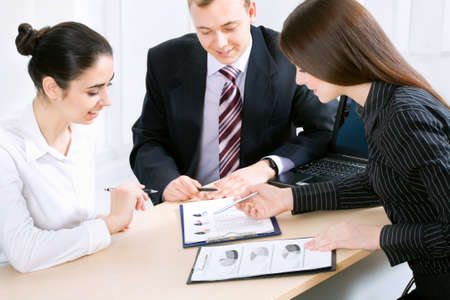 financial guidance: Business people working at the office