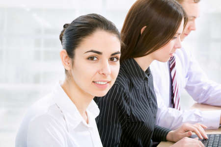 entrepeneur: Portrait of successful businesswoman and business team at office meeting