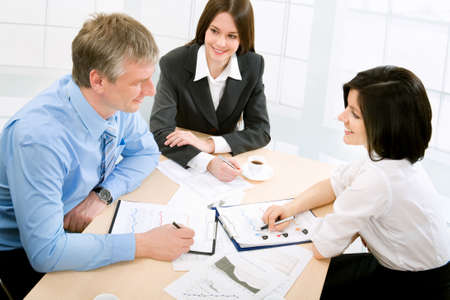 businessmeeting: Image of three business people working at meeting