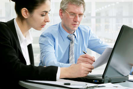 Business people at the office with a laptop photo