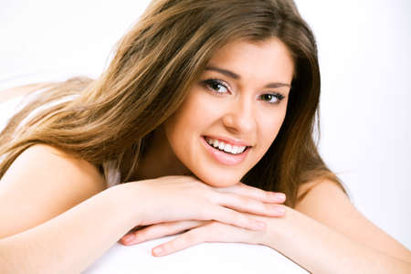 Happy beautiful girl resting on the bed Stock Photo - 10539352