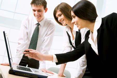 net meeting: Business people at the office with a laptop