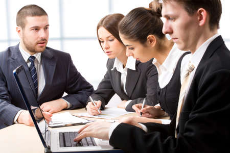 office environment: Business people at a meeting in a  modern office environment