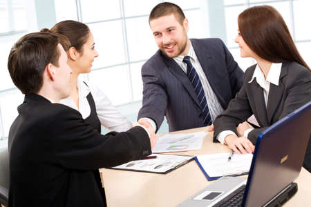 international business agreement: Shaking hands of two business people Stock Photo