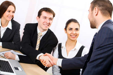 altogether: Shaking hands of two business people Stock Photo