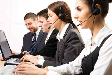 center table: Attractive young people working in a call center