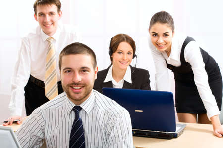 telephony: Team of people working with headsets on in a call center