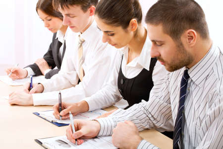 Team of people working in a office Stock Photo - 10672272