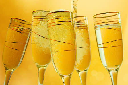 champagne flutes: Champagne flutes making a toast.. Sample text Stock Photo